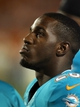 Aug 29, 2013; Miami Gardens, FL, USA; Miami Dolphins running back Lamar Miller on the sideline in the fourth quarter of a game against the New Orleans Saints at Sun Life Stadium. Mandatory Credit: Robert Mayer-USA TODAY Sports