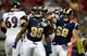 Aug 29, 2013; St. Louis, MO, USA; St. Louis Rams defensive end Gerald Rivers (99) celebrates after sacking Baltimore Ravens quarterback Caleb Hanie (8) during the second half at Edward Jones Dome. St. Louis defeated Baltimore 24-21. Mandatory Credit: Jeff Curry-USA TODAY Sports