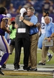 Aug 29, 2013; Minneapolis, MN, USA; Tennessee Titans head coach Mike Munchak (right) hugs Minnesota Vikings head coach Leslie Frazier after the game at Mall of America Field at H.H.H. Metrodome. Vikings win 24-23. Mandatory Credit: Bruce Kluckhohn-USA TODAY Sports