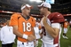 Aug 29, 2013; Denver, CO, USA; Denver Broncos quarterback Peyton Manning (18) and Arizona Cardinals kicker Jay Feely (3) shake hands following the preseason game at Sports Authority Field. The Cardinals defeated the Broncos 32-24. Mandatory Credit: Ron Chenoy-USA TODAY Sports