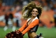Aug 29, 2013; Denver, CO, USA; Denver Broncos cheerleader performs during the third quarter of a preseason game against the Arizona Cardinals at Sports Authority Field. The Cardinals defeated the Broncos 32-24. Mandatory Credit: Ron Chenoy-USA TODAY Sports