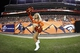 Aug 29, 2013; Denver, CO, USA; A Denver Broncos cheerleader performs in the fourth quarter against the Arizona Cardinals at Sports Authority Field at Mile High. The Cardinals won 32-24. Mandatory Credit: Isaiah J. Downing-USA TODAY Sports