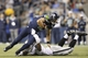 Aug 29, 2013; Seattle, WA, USA; Seattle Seahawks quarterback Brady Quinn (10) is tackled by Oakland Raiders defensive end David Bass (51) during the second half at CenturyLink Field. Mandatory Credit: Joe Nicholson-USA TODAY Sports