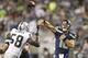 Aug 29, 2013; Seattle, WA, USA; Seattle Seahawks quarterback Brady Quinn (10) passes against the Oakland Raidersduring the second half at CenturyLink Field. Mandatory Credit: Joe Nicholson-USA TODAY Sports