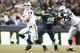 Aug 29, 2013; Seattle, WA, USA; Seattle Seahawks defensive end Benson Mayowa (95) beats a block by Oakland Raiders tackle Willie Smith (79) to force a fumble by quarterback Matthew McGloin (14) during the second half at CenturyLink Field. Mandatory Credit: Joe Nicholson-USA TODAY Sports