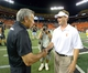 Aug 29, 2013; Honolulu, HI, USA; Southern California Trojans coach Lane Kiffin (left) shakes hands with Hawaii Rainbow Warriors coach Norm Chow after the game at Aloha Stadium. USC defeated Hawaii 30-13. Mandatory Credit: Kirby Lee-USA TODAY Sports