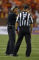 Aug 29, 2013; Honolulu, HI, USA; Hawaii Rainbow Warriors coach Norm Chow (left) disputes a call by field judge Randy Smith against the Southern California Trojans at Aloha Stadium. USC defeated Hawaii 30-13. Mandatory Credit: Kirby Lee-USA TODAY Sports