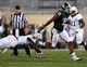 Aug 30, 2013; East Lansing, MI, USA; Michigan State Spartans wide receiver Bennie Fowler (13) sheds the tackle of Western Michigan Broncos defender during 1st half of a game at Spartan Stadium.   Mandatory Credit: Mike Carter-USA TODAY Sports