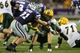 Aug 30, 2013; Manhattan, KS, USA; North Dakota State Bison quarterback Brock Jensen (16) is tackled by Kansas State Wildcats linebacker Jonathan Truman (21) and defensive end Ryan Mueller (44) during the Bisons' 24-21 win at Bill Snyder Family Stadium. Mandatory Credit: Scott Sewell-USA TODAY Sports