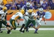 Aug 30, 2013; Manhattan, KS, USA; Kansas State Wildcats quarterback Jake Waters (15) tries to run away from North Dakota State Bison defensive end Kyle Emanuel (53) and defensive tackle Danny Luecke (94) at Bill Snyder Family Stadium. Mandatory Credit: Scott Sewell-USA TODAY Sports