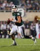 Aug 30, 2013; East Lansing, MI, USA; Michigan State Spartans quarterback Connor Cook (18) scrambles from the pocket against the Western Michigan Broncos during 2nd  half of a game at Spartan Stadium. MSU won 26-13.   Mandatory Credit: Mike Carter-USA TODAY Sports