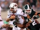 Aug 30, 2013; East Lansing, MI, USA; Western Michigan Broncos quarterback Zach Terrell (11 is sacked by Michigan State Spartans linebacker Denicos Allen (28)  ) during 2nd  half of a game at Spartan Stadium. MSU won 26-13.   Mandatory Credit: Mike Carter-USA TODAY Sports