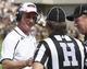 Aug 31, 2013; Cincinnati, OH, USA; Cincinnati Bearcats head coach Tommy Tuberville, left, talks with officials during the first quarter against the Purdue Boilermakers at Nippert Stadium. Mandatory Credit: David Kohl-USA TODAY Sports