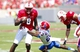 August 31, 2013; Raleigh, NC, USA;  North Carolina State quarterback Brandon Mitchell (8) runs with the ball before being tackled by the  Louisiana Tech defensive back Kentrell Brice (23) during the 1st quarter at Carter Finley Stadium. Mandatory Credit: James Guillory-USA TODAY Sports