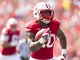Aug 31, 2013; Madison, WI, USA; Wisconsin Badgers running back James White (20) rushes for a touchdown during the third quarter against the Massachusetts Minutemen at Camp Randall Stadium.  Wisconsin won 45-0.  Mandatory Credit: Jeff Hanisch-USA TODAY Sports