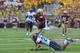Aug 31, 2013; Boston, MA, USA; Villanova Wildcats defensive back Joe Sarnese (20) tackles Boston College Eagles tight end C.J. Parsons (87) during the second half at Alumni Stadium. Mandatory Credit: Bob DeChiara-USA TODAY Sports