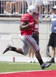 Aug 31, 2013; Columbus, OH, USA; Ohio State Buckeyes running back Jordan Hall (7) scores a touchdown against the Buffalo Bulls at Ohio Stadium. Mandatory Credit: Greg Bartram-USA TODAY Sports