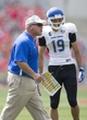 Aug 31, 2013; Columbus, OH, USA; Buffalo Bulls head coach Jeff Quinn directs his offense as Buffalo Bulls wide receiver Alex Neutz (19) listens during a timeout in the game against the Ohio State Buckeyes at Ohio Stadium. Mandatory Credit: Greg Bartram-USA TODAY Sports
