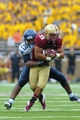 Aug 31, 2013; Boston, MA, USA; Villanova Wildcats defensive back Jerry Miles (29) tackles Boston College Eagles running back Tyler Rouse (35) during the second half at Alumni Stadium. Mandatory Credit: Bob DeChiara-USA TODAY Sports