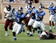 Aug 31, 2013; Durham, NC, USA; Duke Blue Devils wide receiver Jamison Crowder (3) breaks away from the North Carolina Central Eagles defense during a kickoff return for a touchdown at Wallace Wade Stadium. Mandatory Credit: Mark Dolejs-USA TODAY Sports