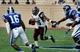 Aug 31, 2013; Durham, NC, USA; North Carolina Central Eagles running back Idreis Augustus (25) gains yardage against the Duke Blue Devils at Wallace Wade Stadium. Mandatory Credit: Mark Dolejs-USA TODAY Sports