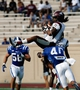 Aug 31, 2013; Durham, NC, USA; North Carolina Central Eagles wide receiver Lamar Scruggs (11) pulls down a pass against Duke Blue Devils safety Dwayne Norman (40) at Wallace Wade Stadium. Mandatory Credit: Mark Dolejs-USA TODAY Sports