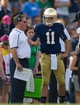 Aug 31, 2013; South Bend, IN, USA; Notre Dame Fighting Irish quarterback Tommy Rees (11) talks with head coach Brian Kelly in the third quarter against the Temple Owls at Notre Dame Stadium. Notre Dame won 28-6. Mandatory Credit: Matt Cashore-USA TODAY Sports