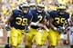 Aug 31, 2013; Ann Arbor, MI, USA; Michigan Wolverines running back Thomas Rawls (38) quarterback Shane Morris (7) and fullback Sione Houma (39) celebrate a touchdown by Rawls second half against the Central Michigan Chippewas t Michigan Stadium. Mandatory Credit: Rick Osentoski-USA TODAY Sports