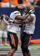 Aug 31, 2013; Houston, TX, USA; Oklahoma State Cowboys running back Jeremy Smith (31) and wide receiver Marcell Ateman (3) celebrate after Smith scores a touchdown during the third quarter against the Mississippi State Bulldogs at Reliant Stadium. Mandatory Credit: Troy Taormina-USA TODAY Sports