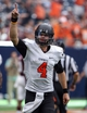Aug 31, 2013; Houston, TX, USA; Oklahoma State Cowboys quarterback J.W. Walsh (4) reacts after the Cowboys score a touchdown during the fourth quarter against the Mississippi State Bulldogs at Reliant Stadium. Mandatory Credit: Troy Taormina-USA TODAY Sports