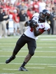 Aug 31, 2013; Iowa City, IA, USA; Northern Illinois Huskies wide receiver Da'Ron Brown (4) makes a catch against the Iowa Hawkeyes during the fourth quarter at Kinnick Stadium. Northern Illinois defeats Iowa 30-27. Mandatory Credit: Mike DiNovo-USA TODAY Sports