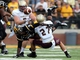 Aug 31, 2013; Hattiesburg, MS, USA; Southern Miss Golden Eagles running back Tyre Bracken (3) fumbles after being hit by Texas State Bobcats safety Colby Targun (27) and defensive lineman Jamie Clavell-Head in the first quarter at M.M. Roberts Stadium. Mandatory Credit: Chuck Cook-USA TODAY Sports