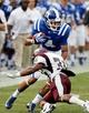 Aug 31, 2013; Durham, NC, USA; North Carolina Central Eagles defensive back Michael Jones (35) tackles Duke Blue Devils wide receiver Johnell Barnes (4) at Wallace Wade Stadium. Mandatory Credit: Mark Dolejs-USA TODAY Sports