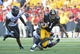 Aug 31, 2013; Iowa City, IA, USA; Northern Illinois Huskies wide receiver Juwan Brescacin (11) makes a catch against Northern Illinois Huskies linebacker Jamaal Bass (6) during the fourth quarter at Kinnick Stadium. Northern Illinois defeats Iowa 30-27. Mandatory Credit: Mike DiNovo-USA TODAY Sports