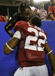 Aug 31, 2013; Atlanta, GA, USA; Alabama Crimson Tide wide receiver Christion Jones (22) kisses an unidentified woman after the 2013 Chick-fil-A Kickoff game at the Georgia Dome. Alabama won 35-10.  Mandatory Credit: Paul Abell-USA TODAY Sports