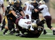 Aug 31, 2013; Hattiesburg, MS, USA; Texas State Bobcats quarterback Jordan Moore (4) is sacked by Southern Miss Golden Eagles defensive linemen Dasman McCullum (45) and Wil Freeman (46) in the second quarter at M.M. Roberts Stadium. Mandatory Credit: Chuck Cook-USA TODAY Sports