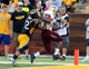 Aug 31, 2013; Hattiesburg, MS, USA; Southern Miss Golden Eagles defensive back Emmanuel Johnson (12) can't keep Texas State Bobcats running back Robert Lowe (28) out of the end zone for a second quarter touchdown at M.M. Roberts Stadium. Mandatory Credit: Chuck Cook-USA TODAY Sports