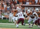 Aug 31, 2013; Austin, TX, USA; Texas Longhorns quarterback David Ash (14) passes the ball against the New Mexico State Aggies during the first half at Darrell K Royal-Texas Memorial Stadium. Mandatory Credit: Brendan Maloney-USA TODAY Sports