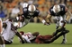 Aug 31, 2013; Auburn, AL, USA; Auburn Tigers running back Tre Mason (21) dives over Washington State Cougars lineman Xavier Cooper (96) and safety Deone Bucannon (20) during the second half at Jordan Hare Stadium.  The Tigers beat the Cougars 31-24. Mandatory Credit: John Reed-USA TODAY Sports