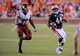 Aug 31, 2013; Auburn, AL, USA; Auburn Tigers running back Cameron Artis-Payne (44) tries to outrun Washington State Cougars safety Deone Bucannon (20) at Jordan Hare Stadium. The Tigers defeated the Cougars 31-24. Mandatory Credit: Shanna Lockwood-USA TODAY Sports