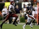 Aug 31, 2013; Auburn, AL, USA; Auburn Tigers running back Cameron Artis-Payne (44) is chased by Washington State Cougars safety Deone Bucannon (20) during the second half at Jordan Hare Stadium.  The Tigers beat the Cougars 31-24. Mandatory Credit: John Reed-USA TODAY Sports