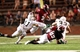 Aug 31, 2013; Troy, AL, USA; Troy Trojans running back Jordan Chunn (36) pushes away UAB Blazers safety Calvin Jones (11) at Veterans Memorial Stadium. The Trojans defeated the Blazers 34-31 in Overtime.  Mandatory Credit: Marvin Gentry-USA TODAY Sports
