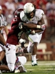 Aug 31, 2013; Troy, AL, USA;  UAB Blazers running back Darrin Reaves (5) is tackled by Troy Trojans defensive back Montres Kitchens (43) at Veterans Memorial Stadium. The Trojans defeated the Blazers 34-31 in Overtime. Mandatory Credit: Marvin Gentry-USA TODAY Sports