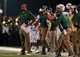 Aug 31, 2013; Troy, AL, USA;  UAB Blazers head coach Garrick McGee (left) watches his team during the game against the Troy Trojans at Veterans Memorial Stadium. The Trojans defeated the Blazers 34-31 in Overtime. Mandatory Credit: Marvin Gentry-USA TODAY Sports