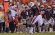 Aug 31, 2013; Auburn, AL, USA; Washington State Cougars quarterback Connor Halliday (12) runs the ball past Auburn Tigers tight end Brandon Fulse (11) at Jordan Hare Stadium. The Tigers defeated the Cougars 31-24. Mandatory Credit: Shanna Lockwood-USA TODAY Sports