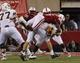 Aug 31, 2013; Lincoln, NE, USA; Nebraska Cornhuskers defender Josh Mitchell (5) sacks Wyoming Cowboys quarterback Brett Smith (16) in the second half at Memorial Stadium. Nebraska won 37-34. Mandatory Credit: Bruce Thorson-USA TODAY Sports