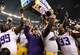 Aug 31, 2013; Arlington, TX, USA; LSU Tigers head coach Les Miles celebrates a win with his team against Texas Christian Horned Frogs at AT&T Stadium. The LSU Tigers beat the TCU Horned Frogs 37-27. Mandatory Credit: Matthew Emmons-USA TODAY Sports