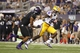 Aug 31, 2013; Arlington, TX, USA; LSU Tigers wide receiver Jarvis Landry (80) runs for a touchdown after catching a pass against TCU Horned Frogs safety Chris Hackett (1) in the fourth quarter of the game at Cowboys Stadium. LSU Tigers beat TCU Horned Frogs 37-27. Mandatory Credit: Tim Heitman-USA TODAY Sports