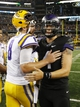 Aug 31, 2013; Arlington, TX, USA; LSU Tigers quarterback Zach Mettenberger (8) meets with TCU Horned Frogs quarterback Casey Pachall (4) after the game at Cowboys Stadium. LSU Tigers beat TCU Horned Frogs 37-27. Mandatory Credit: Tim Heitman-USA TODAY Sports