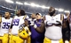 Aug 31, 2013; Arlington, TX, USA; LSU Tigers head coach Les Miles celebrates a victory with his team after the game against the TCU Horned Frogs at Cowboys Stadium. LSU Tigers beat TCU Horned Frogs 37-27. Mandatory Credit: Tim Heitman-USA TODAY Sports